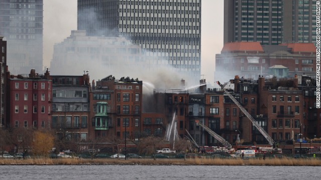 Firefighters battle a nine-alarm fire at a brick brownstone in Boston's Back Bay neighborhood on Wednesday, March 26. Two firefighters died in the blaze.