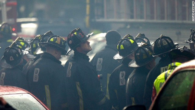 Firefighters watch the blaze.