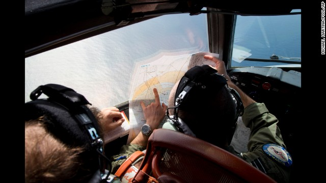 Flight Lt. Jayson Nichols looks at a map aboard a Royal Australian Air Force aircraft during a search on March 27.
