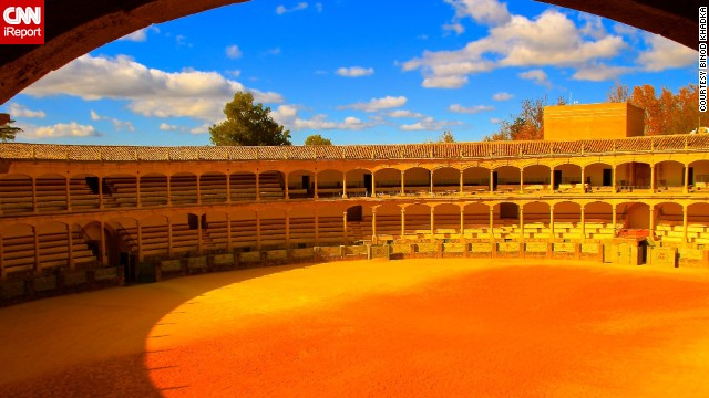 "Bathed in golden sunlight, the <a href='http://ireport.cnn.com/docs/DOC-1079887'>Plaza de Toros</a> is a beautiful monument to Spain's cultural art of bullfighting. Ernest Hemingway ""wrote about famous bullfighting traditions and beauty of the city,"" Binod Khadka said."