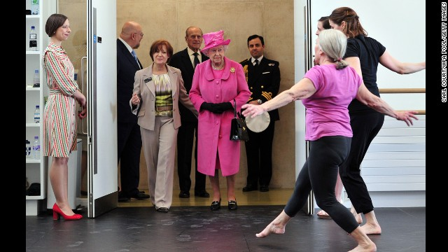 Queen Elizabeth II and Prince Philip, Duke of Edinburgh, watch dancers perform during a visit to the Rambert Dance Company on March 21, 2014, in London.