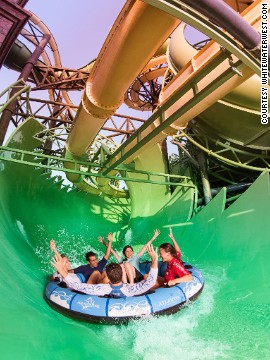 At Aquaventure Waterpark in Dubai, the Aquaconda contains the world's first slide-within-a-slide, comprising an enclosed tube slide that weaves in and out of the framework of a flume-style ride.