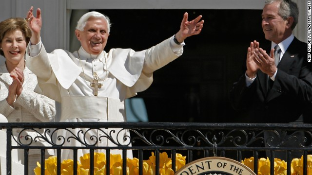 First lady Laura Bush and President George W. Bush applaud as Pope Benedict XVI waves to the crowd at the White House during an arrival ceremony on April 16, 2008.
