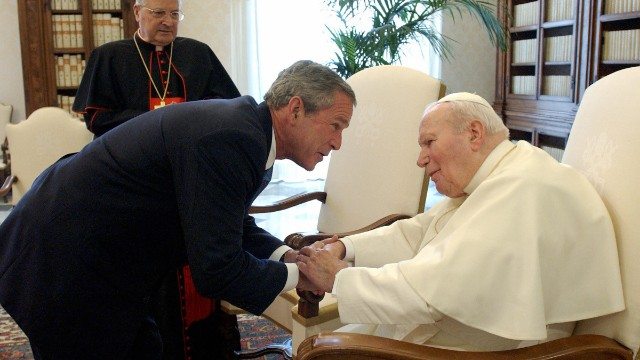 President George W. Bush shakes hands with Pope John Paul II upon his arrival for a private meeting at Vatican June 4, 2004.