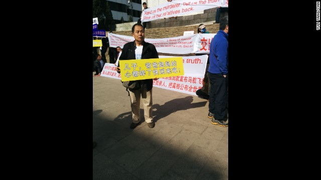 """Saturday morning at family demo outside Lido Hotel, Mr. Wen, father of a MH370 passenger, holding this banner: 'Son, mum & dad's hearts are torn to pieces. Come home quickly!"" By CNN's Yuli Yang, Beijing, March 29. Follow Yuli on Instagram at instagram.com/macchax."