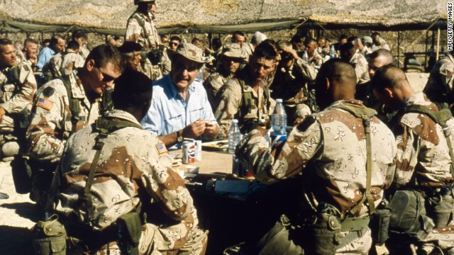 Bush visits American troops in Saudi Arabia on Thanksgiving Day in 1990.