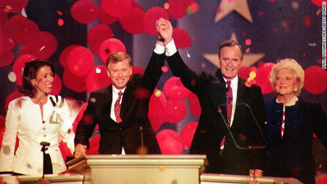 Bush and Quayle join hands at the August 1992 Republican convention in Houston. They are joined by their wives, Marilyn Quayle and first lady Barbara Bush.