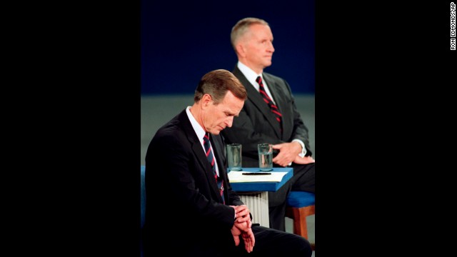 Bush checks his watch during the 1992 presidential debate with Ross Perot, right, and Bill Clinton. The memorable moment was interpreted as the President being out of touch.