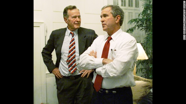Bush watches election returns with his son, George W. Bush, in Austin, Texas, on November 7, 2000. George W. Bush went on to win the presidential election over Democrat Al Gore, but only after a lengthy recount.