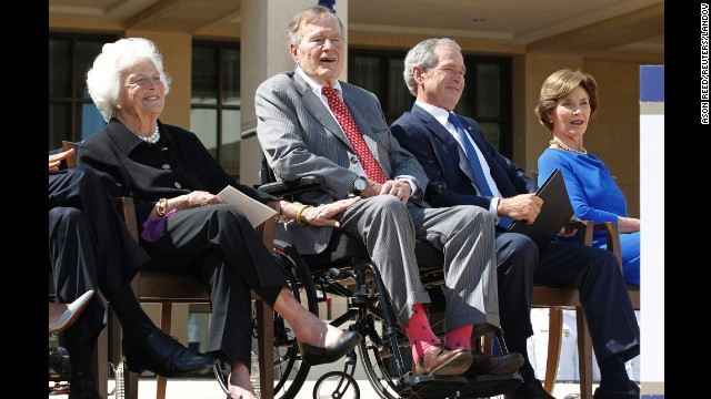 Bush wears socks featuring the American flag at the dedication ceremony for his son's presidential library in Dallas, Texas, in April 2013.