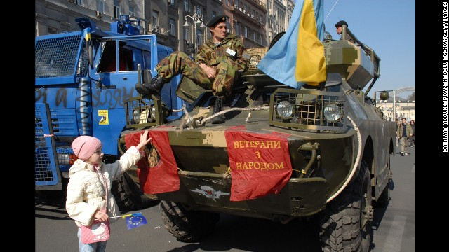 Demonstrators protest Friday, March 28, in Kiev, displaying police vehicles they seized during earlier clashes with authorities.