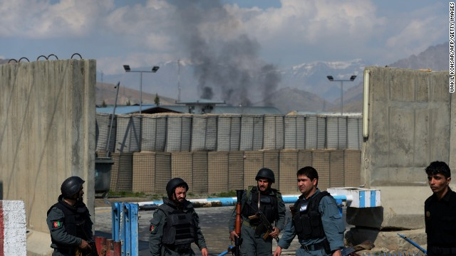 Smoke rises from the compound of the Afghan election commission after an attack by insurgents on Saturday.