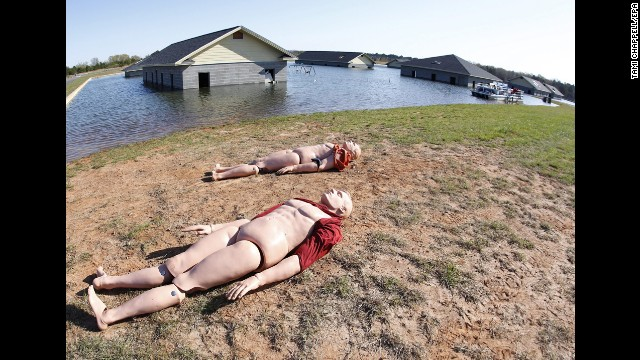 Dummy victims lie next to a flooded area that represents a flooding situation like that during Hurricane Katrina.