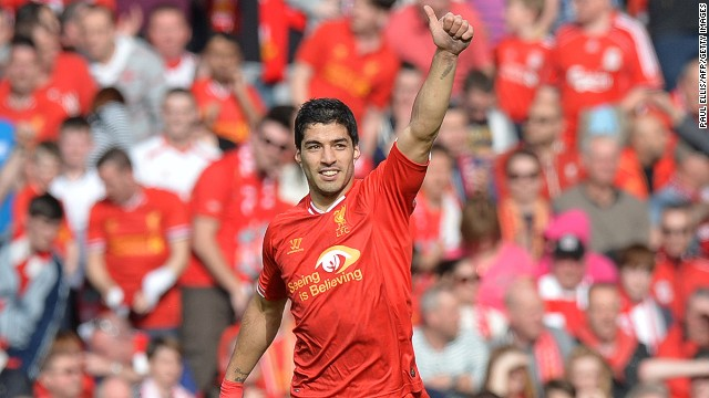 Luis Suarez acknowledges the Anfield crowd after scoring Liverpool's second goal against Spurs on Sunday.