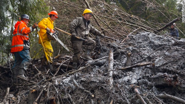 Rescue workers dig through mud and debris near Darrington, Washington, on Saturday, March 29.