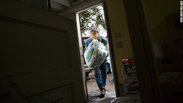Darryl Perkins helps unload donated items at the First Baptist Church in Darrington. He is one of the hundreds of townspeople who have dropped everything to help. He has been working 12-16 hours a day to help sort donations and make deliveries to those in need.