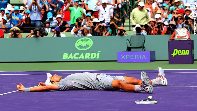 Novak Djokovic collapses in exhausted joy after winning the Miami Masters final against Rafael Nadal.