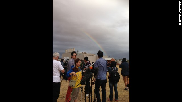 """As the media sets up their cameras and mics to film the first Australian P3 return to the airbase from search on March 29, a rainbow pokes out from behind the clouds."" By CNN's Elizabeth Joseph at RAAF Base Pearce, March 29. Follow Elizabeth on Instagram at instagram.com/ejo1224."