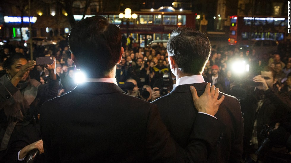 MARCH 31 - LONDON, UK: Gay couple Peter McGraith (right) and David Cabreza speak to the press after getting married shortly after midnight at Islington Town Hall at one of the UK's first same-sex weddings on March 29. <a href='http://www.cnn.com/2014/03/28/world/europe/uk-same-sex-marriage/'> England and Wales are among 15 countries</a> as well as parts of the United States and Mexico that allow gay marriage.
