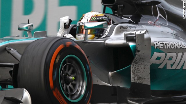 Formula One driver Lewis Hamilton pumps his fist after winning the Malaysian Grand Prix on Sunday, March 30.