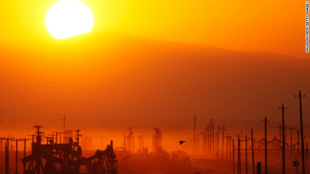 The sun rises over an oil field over the Monterey Shale formation near Lost Hills, California, on March 24, 2014. Gas and oil extraction there using hydraulic fracturing, or fracking, is on the verge of a boom.