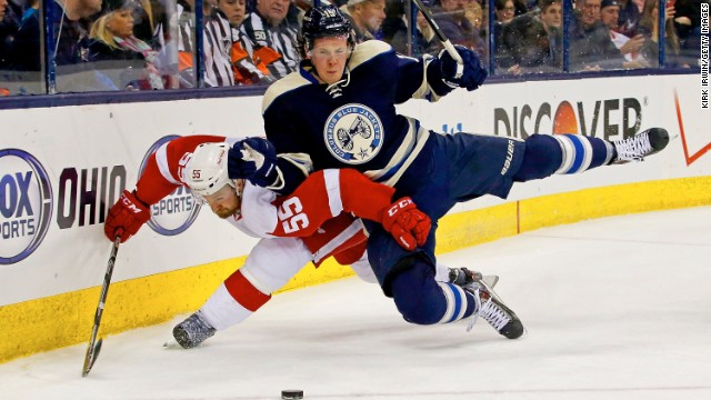 Detroit's Niklas Kronwall, left, and Columbus' Ryan Johansen lose their footing as they chase a puck during an NHL hockey game Tuesday, March 25, in Columbus, Ohio.