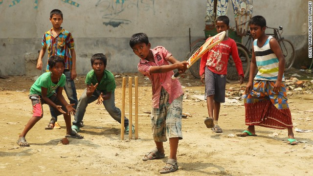 Children play cricket in the streets while the World Twenty20 competition takes place in Dhaka, Bangladesh, on Thursday, March 27.