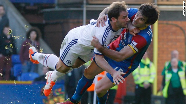 Crystal Palace's Mile Jedinak, right, tussels with Chelsea's Branislav Ivanovic during a Premier League soccer match Saturday, March 29, in London.