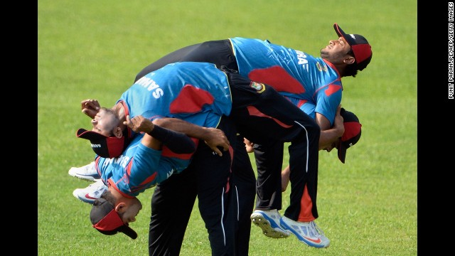 Bangladeshi cricket players warm up during training Thursday, March 27, for the World Twenty20 tournament in Dhaka, Bangladesh.