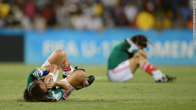 Mexican soccer players are dejected after losing to Japan in the quarterfinals of the FIFA U-17 Women's World Cup on Thursday, March 27. See 30 amazing sports photos from last week