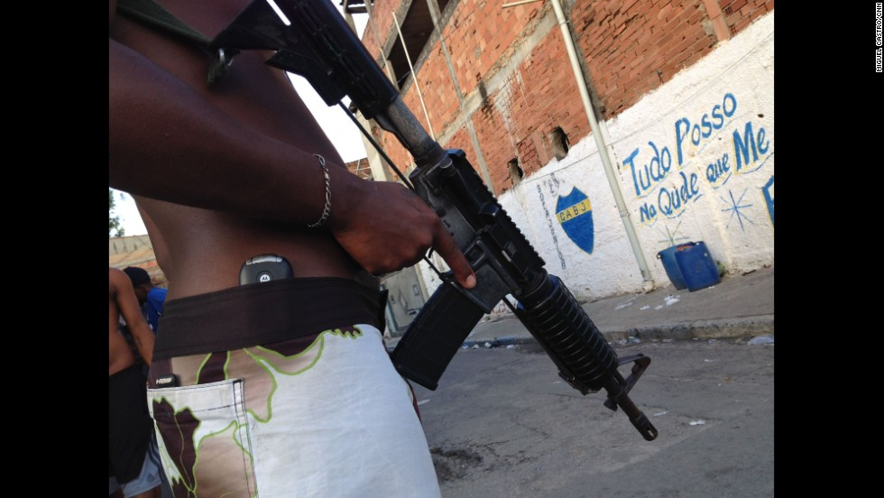 "RIO DE JANEIRO: ""Drug trafficker stands guard with an AR-15 automatic rifle in an undisclosed Rio favela."" - CNN's Miguel Castro. Brazil has stepped up efforts to secure its notorious slums ahead of the World Cup. Watch CNN's Shasta Darlington's report at <a href='http://edition.cnn.com/video/data/2.0/video/world/2014/04/24/pkg-darlington-brazil-army-occupation.cnn.html'>CNN.COM</a>. Follow Miguel (<a href='http://instagram.com/sambassando' target='_blank'>@sambassando</a>) and other CNNers along on Instagram at <a href='http://instagram.com/cnn' target='_blank'>instagram.com/cnn</a>."