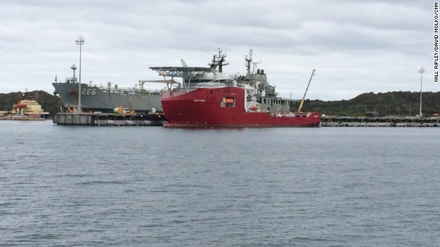 Australian Defense Vessel Ocean Shield prepares to sail for the search zone, with the pinger locator and underwater drone already on board.