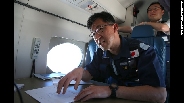 Kojiro Tanaka, head of the Japanese coast guard search mission, explains the efforts en route to the search zone April 1.