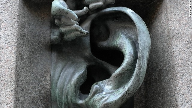 "The Quardrilatero del Silenzio features architectural oddities such as a giant doorbell in the shape of an ear. The ""silent"" neighborhood also has mosaics, weird statues and secret gardens swarming with flamingos."