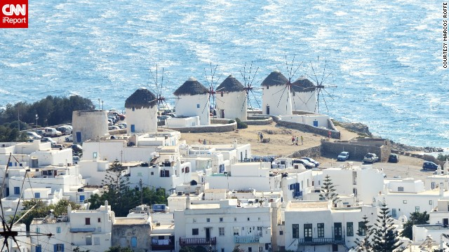The snow white windmills of Mykonos, Greece, contributed to the island's economic prosperity between the 17th and 19th centuries. Their importance declined with the rise of industrialization, but a small cluster of them still stand above the Aegean Sea.