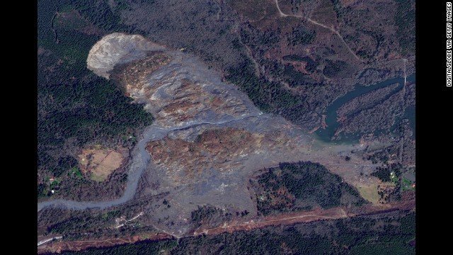 This satellite image taken on Monday, March 31, shows the path of the landslide.