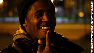 Williams shows his chipped tooth from running races with other kids inside Chicago\'s infamous Cabrini Green high rise.