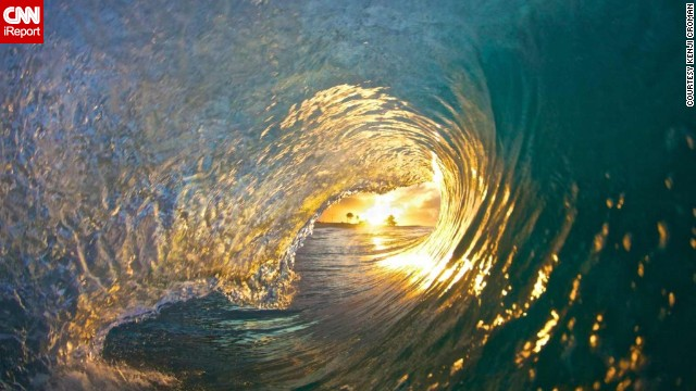 "It took Croman six months to get what he calls ""the Shot,"" taken at Sandy Beach. He woke up at 4:30 every morning to try and photograph the sun inside the barrel of a wave."