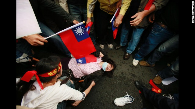 A supporter of the trade pact between China and Taiwan faints during clashes between protesters and police in Taipei, Taiwan, on Tuesday, April 1. Protesters, mostly college students, have been camped out in Taiwan's Legislature building since March 18. They say the trade deal with China could harm Taiwan's economy, democratic system and national security. But supporters of the deal have also come out to express themselves.