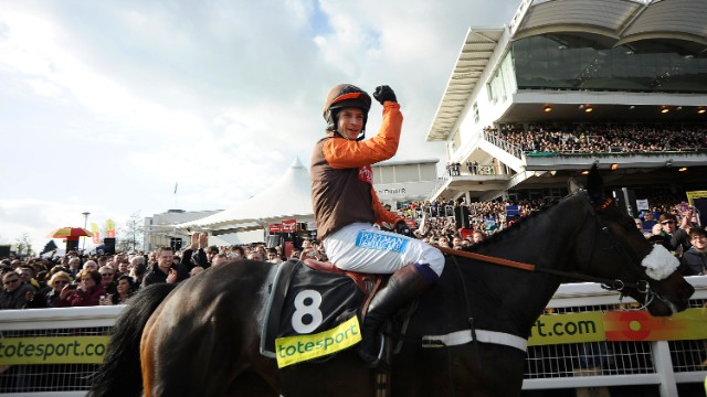Waley-Cohen is no stranger to victory on Long Run, his mount on Saturday. Here he celebrates winning the 2011 Cheltenham Gold Cup.