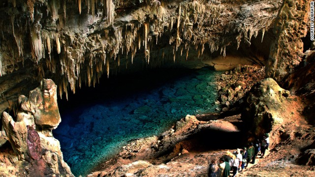 """Gruta do Lago Azul The """"Blue Lake Grotto"""" is part of one of the world's largest flooded cavities. Its blue waters extend more than 200 feet deep. The mysterious source of the lake is believed to be an underground river, but that has yet to be located. The grotto is rich with prehistoric treasures. A Franco-Brazilian expedition in 1992 uncovered thousands of prehistoric animal bones, including saber-tooth tigers and giant sloths. More info: www.portalbonito.com.br MORE: Are these the world's best drummers?"""