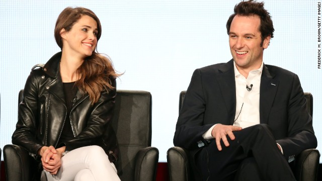 """The Americans"" actors Keri Russell and Matthew Rhys are so good at playing a couple on the screen they have several onlookers wondering if they're a match in real life. Russell, who broke up with her husband of almost seven years in December, <a href='http://www.people.com/people/article/0,,20802179,00.html' target='_blank'>has been seen spending quality time off-set with her co-star</a>. If they do become an item, they'll join these famous couples whose romance went from reel to real:"