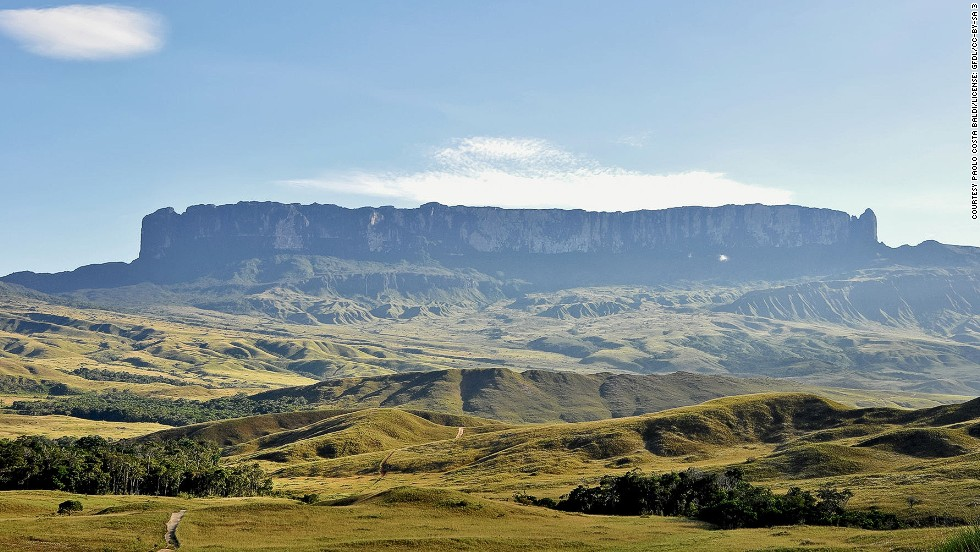 "The World Cup may take center stage in Brazil over the next few weeks, but if you're traveling here, it's worth taking time away from the bars, pub, stadia and TV screens to enjoy some of the country's most beautiful assets. <!-- --> </br><!-- --> </br><strong>Mount Roraima</strong><!-- --> </br>Mount Roraima staddles the border between Brazil, Guyana and Venezuela. Its rock formations, rivers and waterfalls are said to have inspired Sir Arthur Conan Doyle's book, ""The Lost World."" More recently, Mount Roraima served as inspiration for a location in Disney/Pixar's ""Up."" The trip up Roraima can take seven to 10 days, but the return hike takes two and hikers are rewarded with waterfall baths along the way.<!-- --> </br><i><a href='http://www.turismo.rr.gov.br/' target='_blank'>Mount Roraima</a></i><i>, Roraima; +55 95 2121 2561</i><!-- --> </br><a href='http://edition.cnn.com/2013/07/04/travel/brazil-10-things/index.html'>MORE: 10 things to know before visiting Brazil</a>"