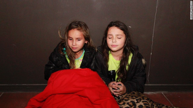 Girls wait in a hallway before evacuating Iquique on April 1. A tsunami warning was in effect for Chile, Peru, Ecuador, Colombia and Panama.