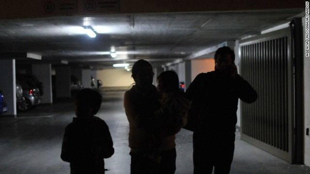 Iquique residents wait in a parking garage after the earthquake on April 1.