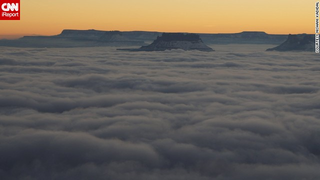 "From the Green River Overlook in Canyonlands National Park in Moab, Utah, the Island in the Sky mesa surrounded by clouds of fog looks almost majestic. ""It felt heavenly to be there at that time,"" Nishani Kadidal said."