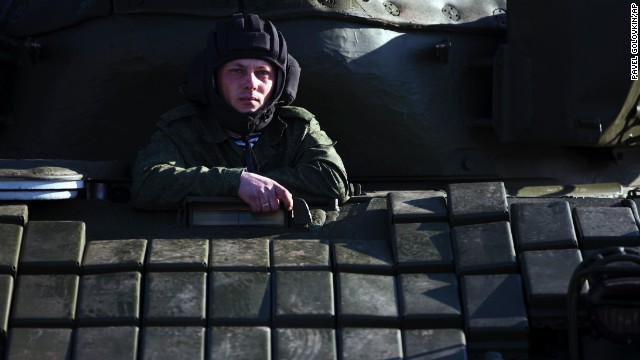 A Russian solder sits in a tank at the Ostryakovo railway station, not far from Simferopol on March 31.