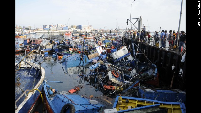 Fishing boats washed ashore by a tsunami sit in the waters of Iquique, Chile, on Wednesday, April 2. A magnitude-8.2 earthquake struck off the coast of northern Chile on Tuesday, April 1, triggering small landslides and prompting evacuations of coastal areas. At least six people were reported dead.