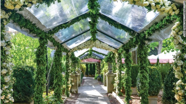 Designer Preston Bailey believes in setting the tone for an event right from the start. A bower of flowers creates a magical entrance to the celebration.
