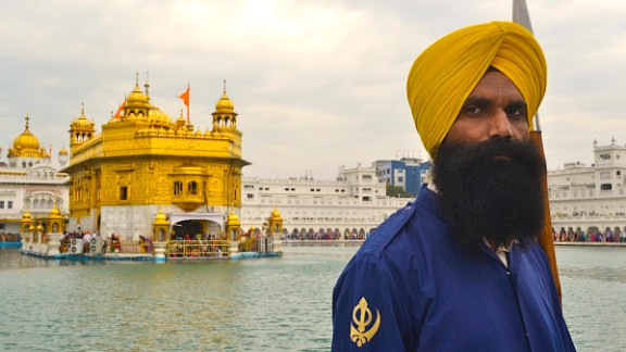 A guard stands next to the scared pond at Amritsar's Golden Temple, considered the holiest of all sites for Sikhs.